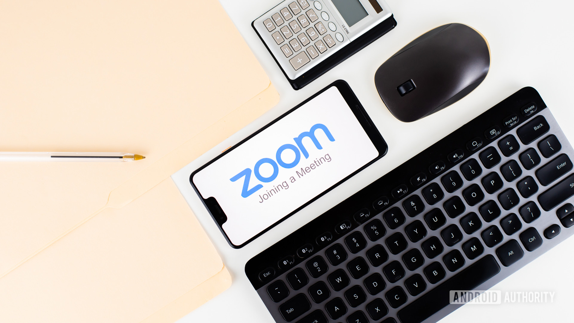 Zoom-Meetings-on-smartphone-next-to-office-equipment-stock-2